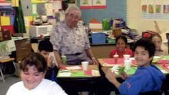Mentor Mike Axelrod with students at Mary Buren School in Guadalupe